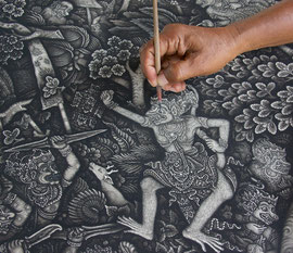 Bali, Batuan: Dewa Gede Mandra, adding detail to a figure in a scene from the Ramayana saga