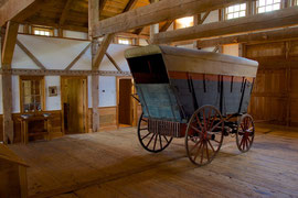 A 19th century waggon stands at the north end of the barn