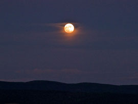 Looking east at the moon rising above the Taconic Hills