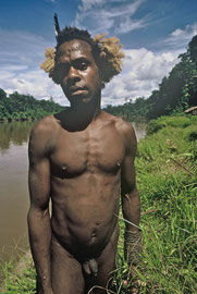 W. Papua, Asmat: a warrior from Monu village about to embark on a headhunting raid further up the Undir river
