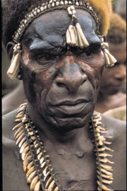 W. Papua, Asmat: Betakam, a chief of Basim. His chest scars are deliberate burn marks — intended to draw out pain within his body