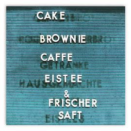 StadtSicht 141b: Verkaufsschild John Baker mit dem Text: Cake Brownie Caffe