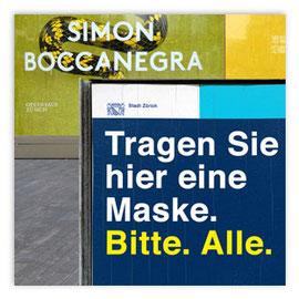 """StadtSicht 144c: Plakat """"Tagen Sie hier eine Maske!"""" Sechseläutenplatz Zürich"""