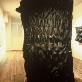 "body work #8, handsewn rubber & linen thread,  118"" x 72"" x 30"", 1998"