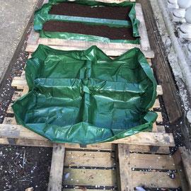 ...garden bin liners nailed to inner frame...