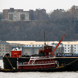 Bruce McCallister and barge and Jersey shore, Hudson River