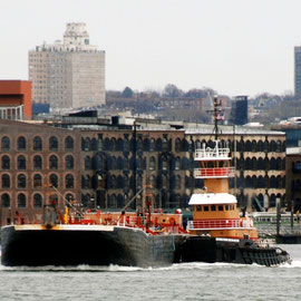 Scott tug and barge with Red Hook warehouses and trams