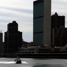 UN building and police patrol East River