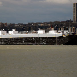 Na Hoku and barge moored in Hudson and Jersey shore