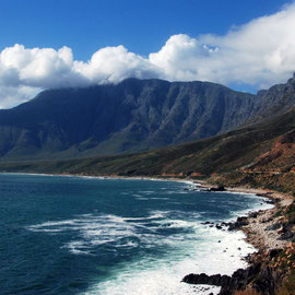 A big sea pulsing into False Bay and onto the boulders