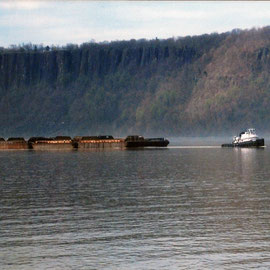 Tug and barge train on the Hudson with Jersey Palisades