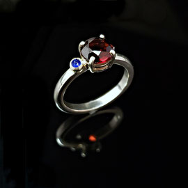 AN 77 - Sterling ring with garnet and bezel set sapphire.