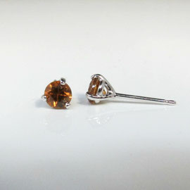 AN 25 - 14K white gold martini style earrings with zircons.