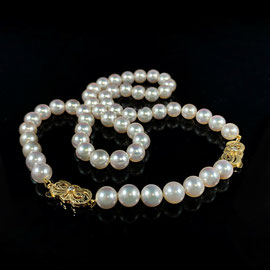 AN 143 - Mikimoto pearls with 18K yellow gold catch with accent diamond - with 4 inch extender.