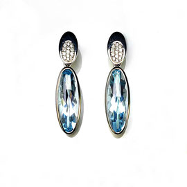 E 488 - 14K white gold earrings with long oval blue topaz and .14 ct tw diamonds.