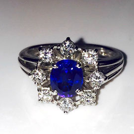 AN 40 - 14K white gold estate ring with diamonds and center sapphire.