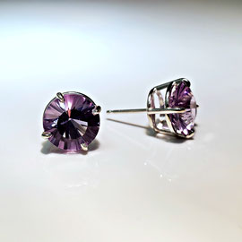 E 521 - Sterling earrings with starburst amethyst.