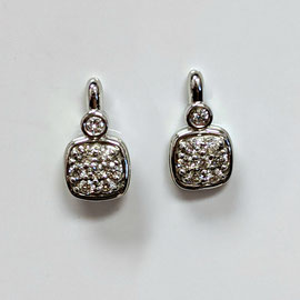 AN 135 - 14K white gold doorknocker style earrings with diamonds.