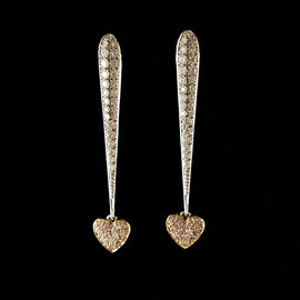 E 496 - 18K rose and white gold earrings with .51 ct tw diamonds.