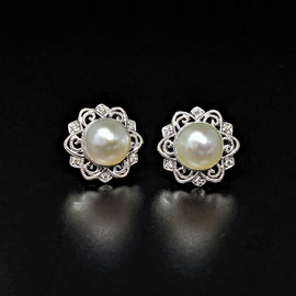 AN 146 - 14K white gold lacy earring jackets with .07 ct. tw. diamonds.  Pearls sold separately