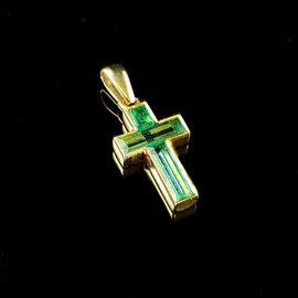 P 159 - 18K yellow gold cross pendant with emerald baguettes.