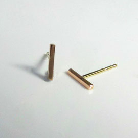 AN 11 - 14K rose gold bar earrings with yellow gold posts.