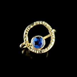 R 392 - 14K yellow gold ring with bezel set sapphire inside hammered circle.