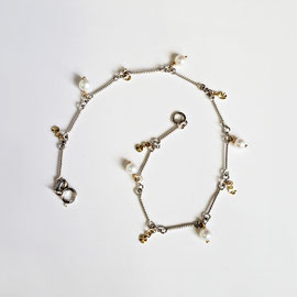AN 69 - 14K white gold  twist bar bracelet with pearls and yellow gold dangles.