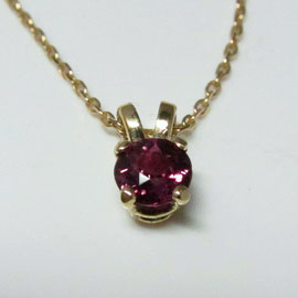 AN 23 - 14K yellow gold basket style pendant with rhodolite garnet.