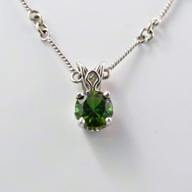 P 104 - 14K white gold pendant with green tourmaline.
