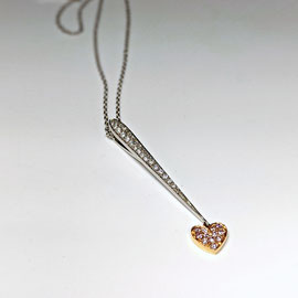 P 128 - 18K rose and white gold pendant with .31 ct tw diamonds, on a cable chain.