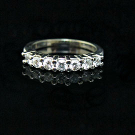 AN 46 - 14K white gold band with diamonds set with shared prongs.