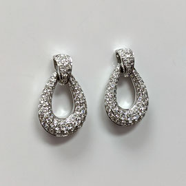 AN 131 - 14K white gold door knocker style earrings with diamonds.