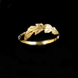 R 385 - 14K yellow 'feather' ring with hammered finish.