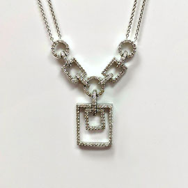 AN 137 - 14K white gold necklace with diamonds.