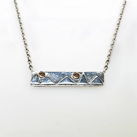 P 149 - Sterling cable chain with decorative bar.