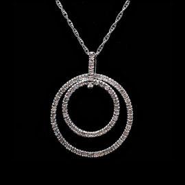 AN 34 - 14K white gold pendant with diamonds.