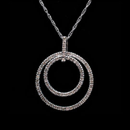 AN 34 - 14K white gold pendant with diamonds.