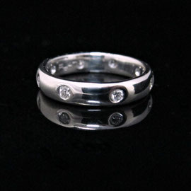 R 377 - Platinum band with flush set diamonds.