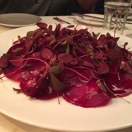 Thinly sliced beets with daikon microgreens.