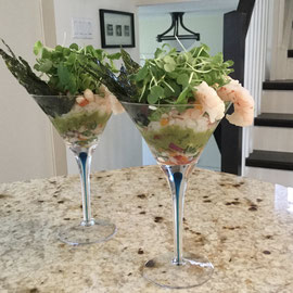 De-constructed sushi cocktail with wasabi microgreens on top.