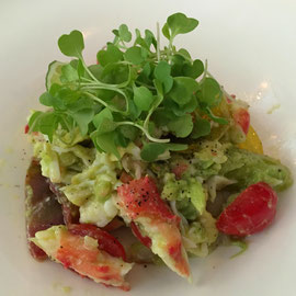 Crab & avocado salad with microgreens.