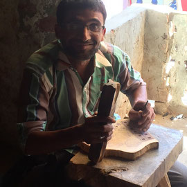 Wood block print carver with a handicap - they also have a chance to work