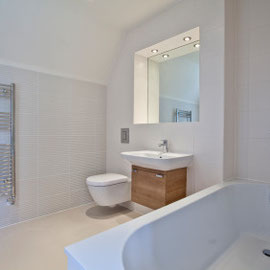 Bathroom renovation with modern fittings and simple uncluttered design in Twickenham