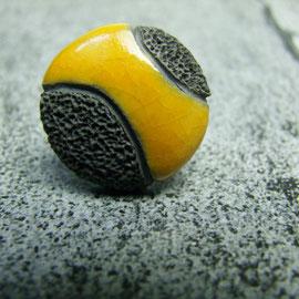 voir bague ceramique jaune noir