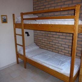 ein Schlafzimmer mit  einem Stockbett