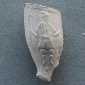 Man met harpoen en vis, op andere zijde een scheepje met initialen I H P of I A P