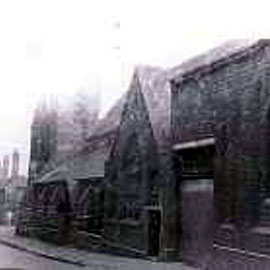 St Laurence' church viewed from Love Lane looking towards the junction with Dartmouth Street