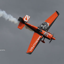 French pilot Nicolas Ivanoff with his orange raceplane. August 15th 2015