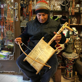 Mr K. Khatib at his Gift shop in the Old City in Jerusalem, playing a traditional Bedouin musical instrument. 23/2/2016